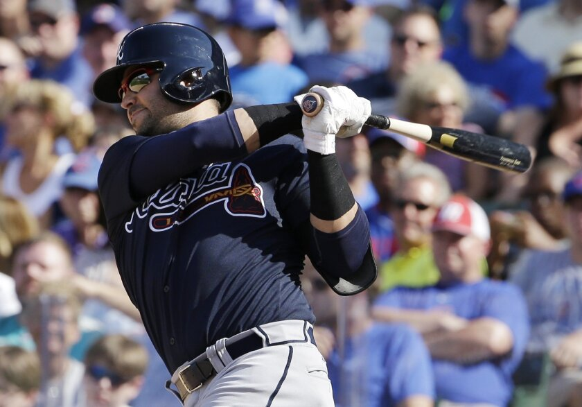 Atlanta Braves' Nick Swisher hits a two-run home run against the Chicago Cubs during the fifth inning of a baseball game Saturday, Aug. 22, 2015, in Chicago. (AP Photo/Nam Y. Huh)