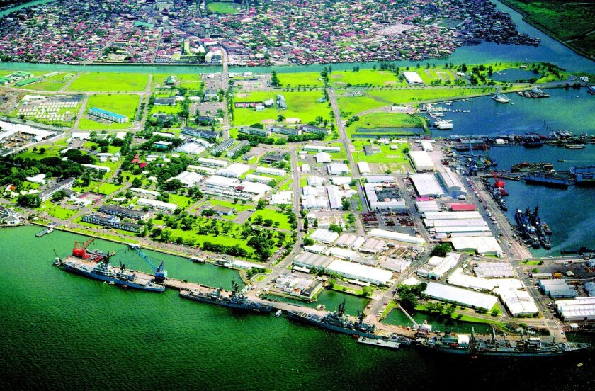 A view of U.S. Naval Base Subic Bay in the Philippines with the city of Olongapo in the background in 1981. The ships docked at the pier in the foreground (from left): guided missile cruiser William H. Standley, guided missile destroyer Henry B. Wilson, guided missile destroyer Sterett and oiler Ha