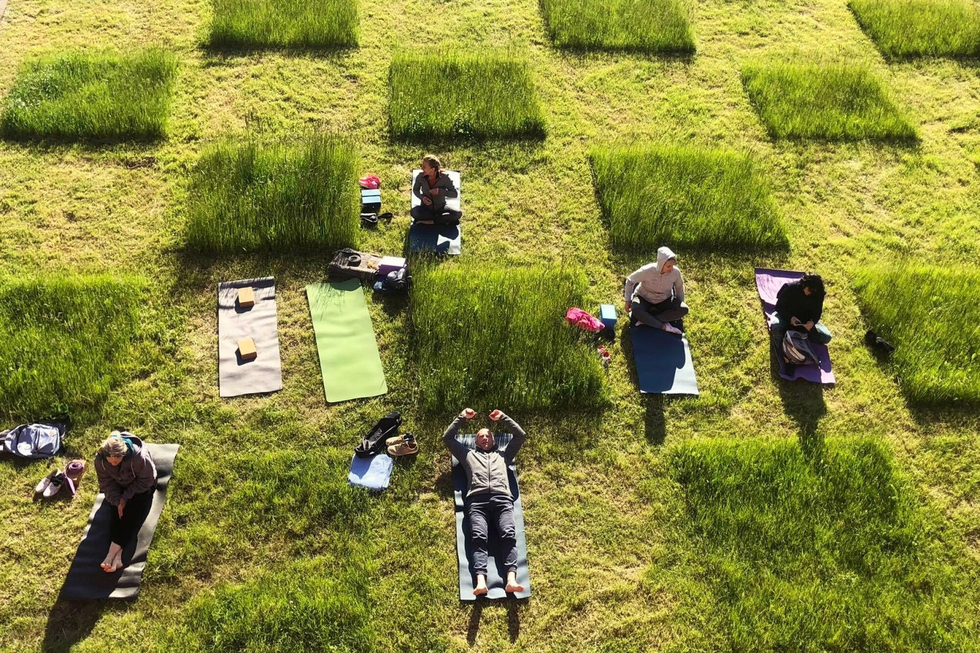 In Elblag, Poland, grass mowed in a checkboard pattern delineated social distancing for those seeking an outdoor reprieve.