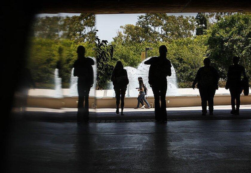 Students walk between Lough Memorial Fountain and Brotman Hall at Cal State Long Beach.