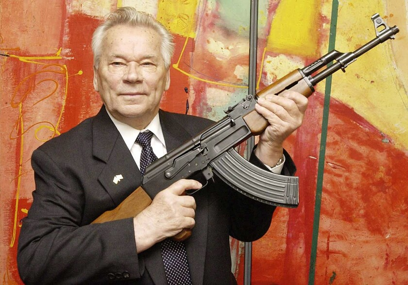 Mikhail Kalashnikov with his legendary assault rifle at a weapons museum in Suhl, Germany, in 2002.