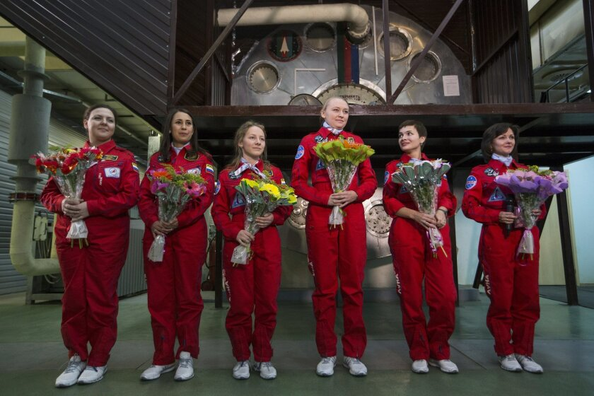 From left, Daria Komissarova, Tatyana Shuguyeva, Polina Kuznetsova, Inna Nosikova, Anna Kussmaul and Elena Luchitskaya answer questions after the eight-day imitation flight to the moon at a mock-up spaceship, in Moscow, Russia, Friday, Nov. 6, 2015. The six-woman crew climbed into a grounded space