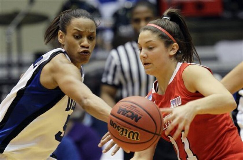 Duke's Jasmine Thomas, left, steals the ball from Marist's Leanne Ockenden (11) during the first half in the second-round of an NCAA women's college basketball tournament, Monday, March 21, 2011, in Durham, N.C. (AP Photo/Gerry Broome)