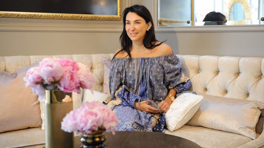 Colette Steckel sits in her 344-square-foot store on Melrose Place that opened its doors on June 9.