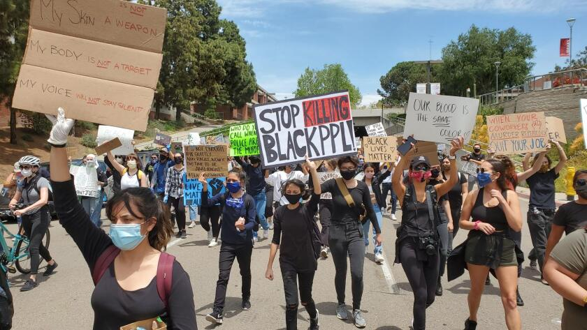 Youth protesters march Monday afternoon through San Diego to Balboa Park demonstrating against police brutality.
