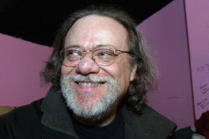 Tommy Ramone, former drummer for the Ramones, smiles during a backstage interview at the Knitting Factory in New York in January 2005.