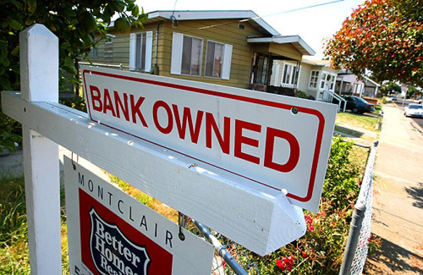 A sign is posted in front of a foreclosed home for sale on June 13, 2008, in Richmond, Calif.