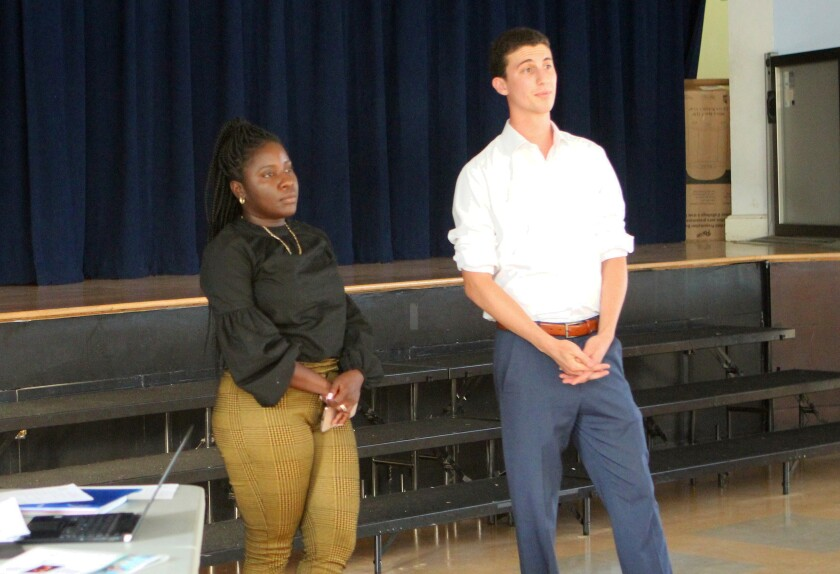 Chevelle Tate, field rep for State Senator Toni Atkins, introduces her successor, Miller Saltzman, to attendees of the Bird Rock Community Council meeting, Sept. 3 in the Bird Rock Elementary School auditorium.