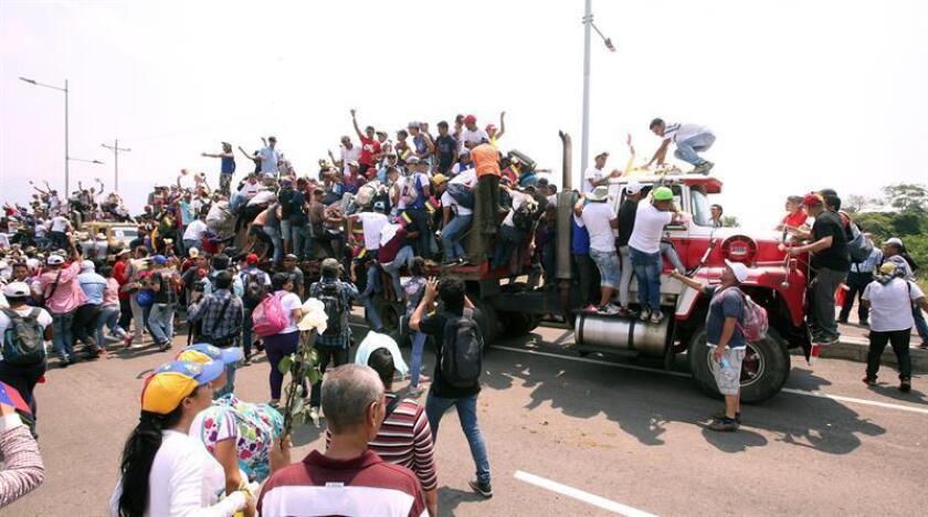 Venezuelans ride on trucks carrying humanitarian supplies in Cucuta, Colombia, on Feb. 23, 2019. EPA-EFE/Mauricio Dueñas Castañeda