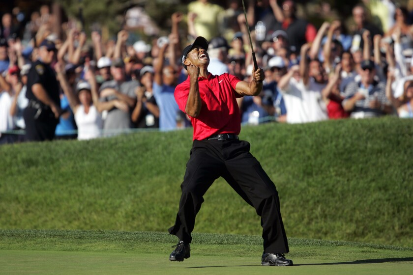 Tiger Woods celebrates 12-foot birdie putt on 18th hole in 2008 U.S. Open at Torrey Pines that forced Monday playoff.