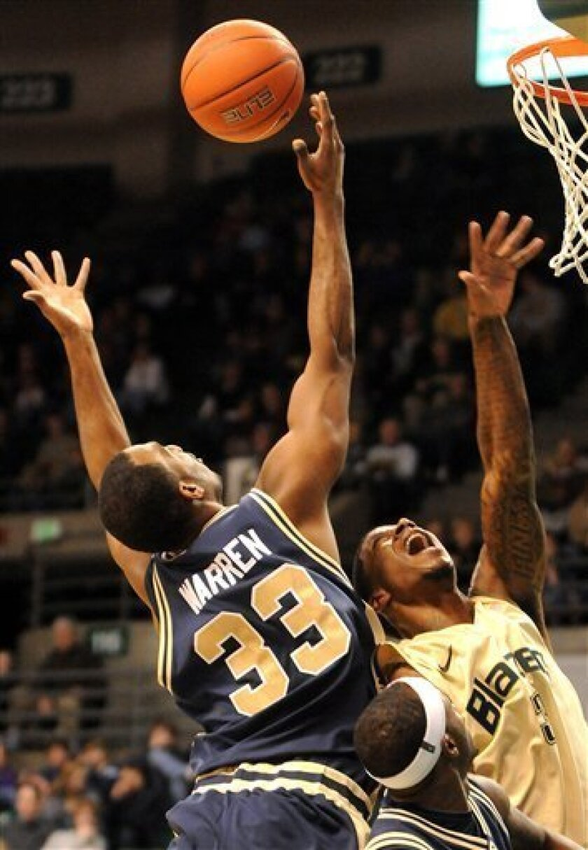 George Washington's Daymon Warren (33) and UAB's Anthony Criswell (3) reach for a rebound during the first half of an NCAA college basketball game at Bartow Arena in Birmingham, Ala., Monday, Dec. 27, 2010. (AP Photo/The Birmingham News, Mark Almond)