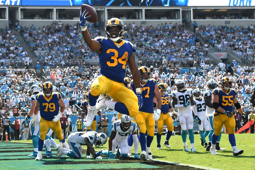 Rams running back Malcolm Brown celebrates his second touchdown against Carolina.