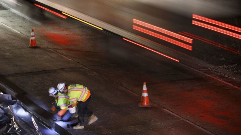 Contractors work on the 101 Freeway in the San Fernando Valley in 2017.