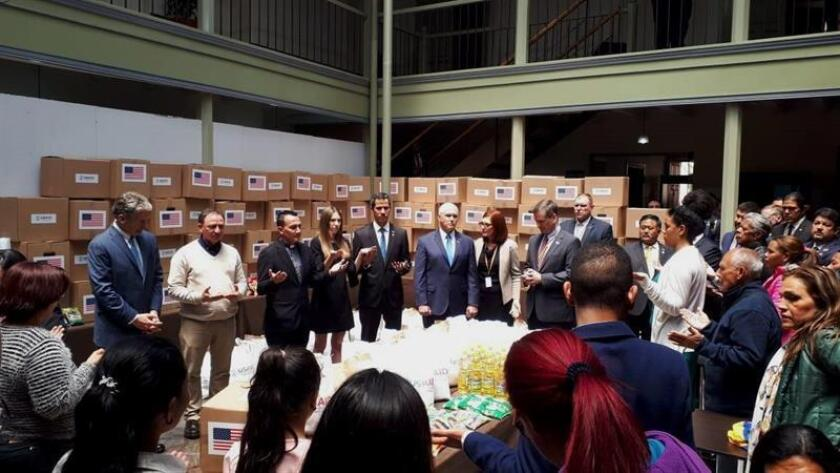 Venezuelan self-proclaimed acting president Juan Guaido (c.), seen here on Feb. 26, 2019, in a storehouse full of humanitarian aid with his wife Fabiana Rosales (c.l.), US ambassador to Colombia, Kevin Whitaker (l.), and US Vice President Mike Pence (c.r.), plans to start his return to Caracas this Tuesday EFE-EPA/US Embassy in Colombia