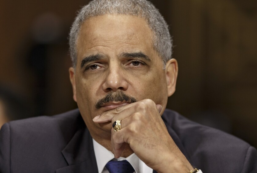 """In a speech at Georgetown University, Attorney General Eric Holder noted that an estimated 5.8 million Americans are prohibited from voting because of felony convictions, and said that the impact of such exclusion on racial minorities was """"disproportionate and unacceptable."""" Holder is seen above on Capitol Hill testifying before the Senate Judiciary Committee on Jan. 29."""