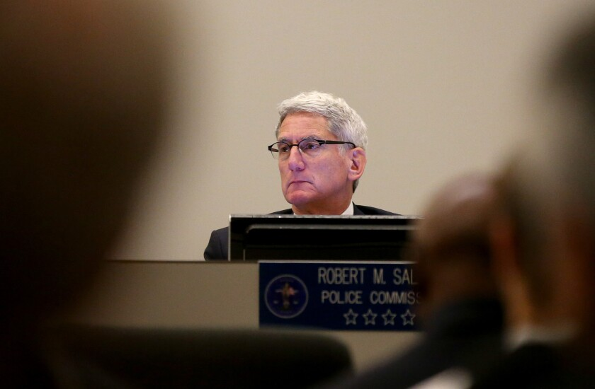 Los Angeles Police Commissioner Robert Saltzman listens to comments from the public on his last day serving on the panel on Tuesday. Saltzman served nine years on the police oversight board.