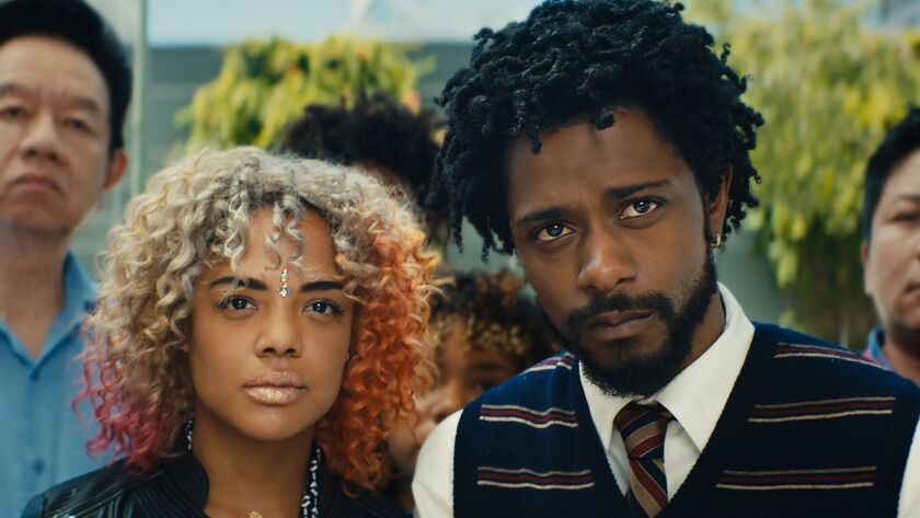 """Lakeith Stanfield and Tessa Thompson in """"Sorry to Bother You."""""""
