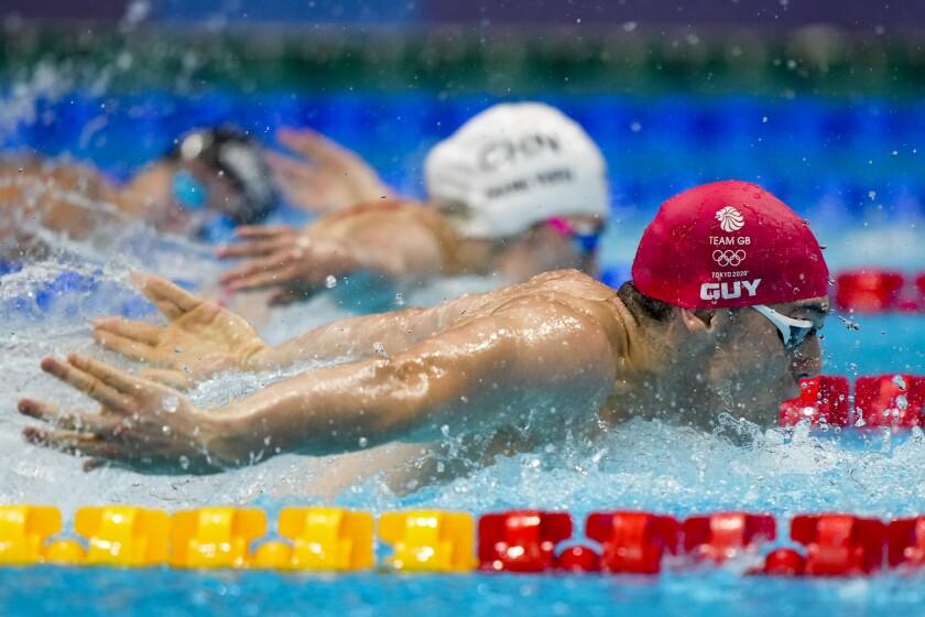 James Guy, of Britain, swims in a mixed 4x100-meter medley relay at the 2020 Summer Olympics, Saturday, July 31, 2021, in Tokyo, Japan. Britain won the gold medal. (AP Photo/David Goldman)