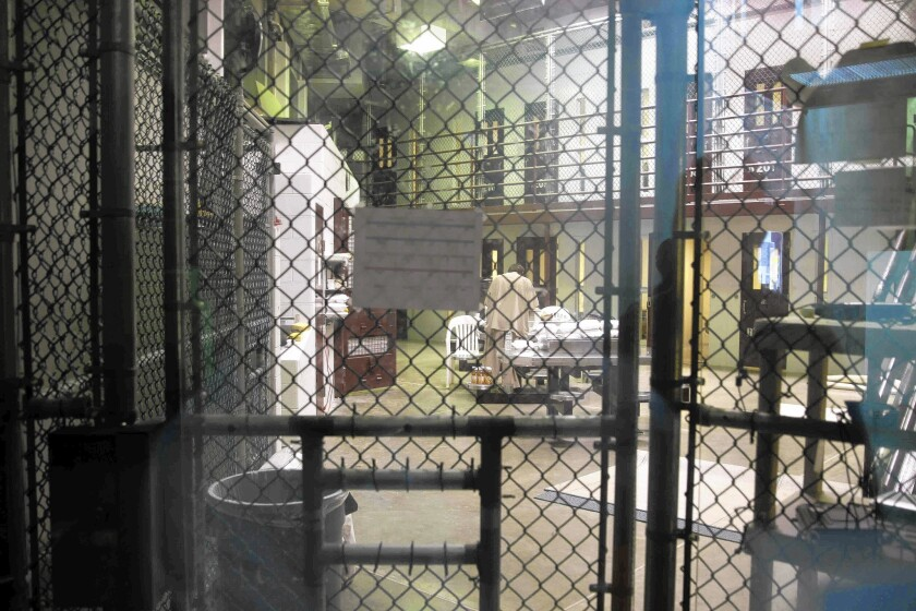 A prisoner stands with his back turned inside Camp 6 at the U.S. military prison at Guantanamo Bay, Cuba.