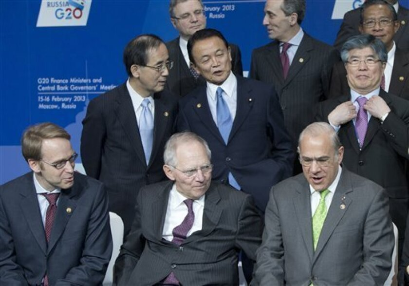 German Central Bank Governor Jens Weidmann, front left, German Finance Minister Wolfgang Schauble, front center, Governor of the Bank of Japan, Masaaki Shirakawa, rear left, talks with Japanese Finance Minister Taro Aso, center, and South Korea Central Bank Governor Kim Choong-soo, rear right, atte
