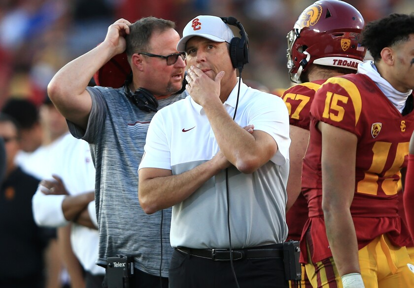 USC coach Clay Helton looks on from the sideline during the Trojans' victory over UCLA.