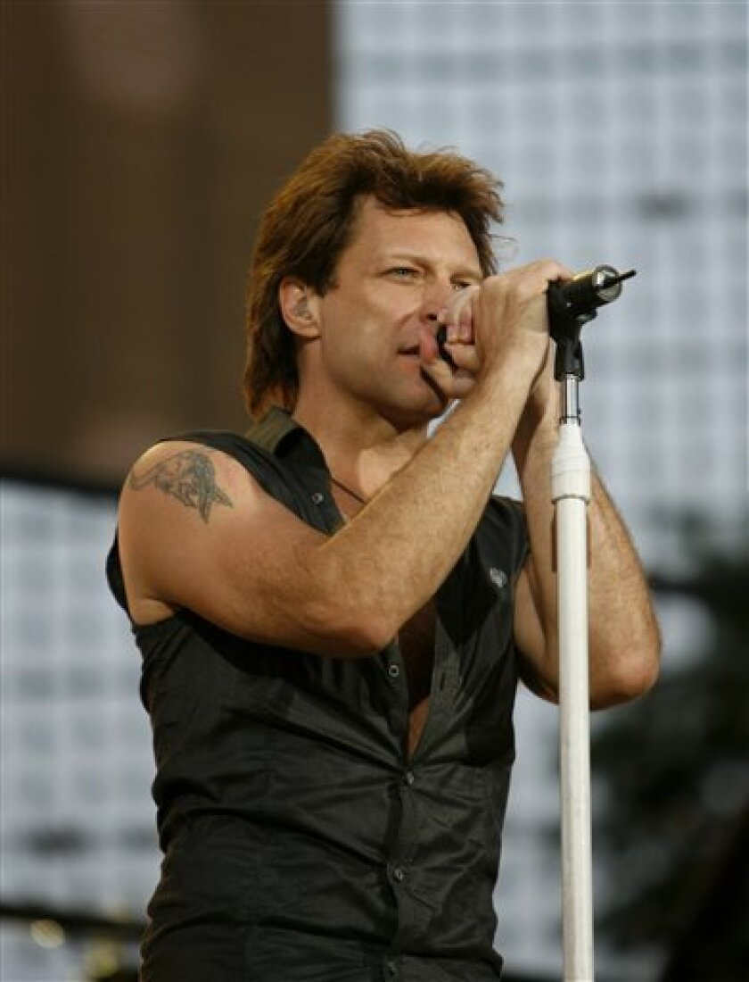 In this Saturday, July 12, 2008 file photo, Jon Bon Jovi of Bon Jovi performs during a free concert celebrating Major League Baseball All-Star Summer on Central Park's Great Lawn in New York. Bon Jovi will rock the New Orleans Jazz & Heritage Festival for the first time on May 2, 2009, returning to Louisiana after donating $1 million in 2005 to build homes for families displaced by Hurricane Katrina. (AP Photo/Jason DeCrow/File)