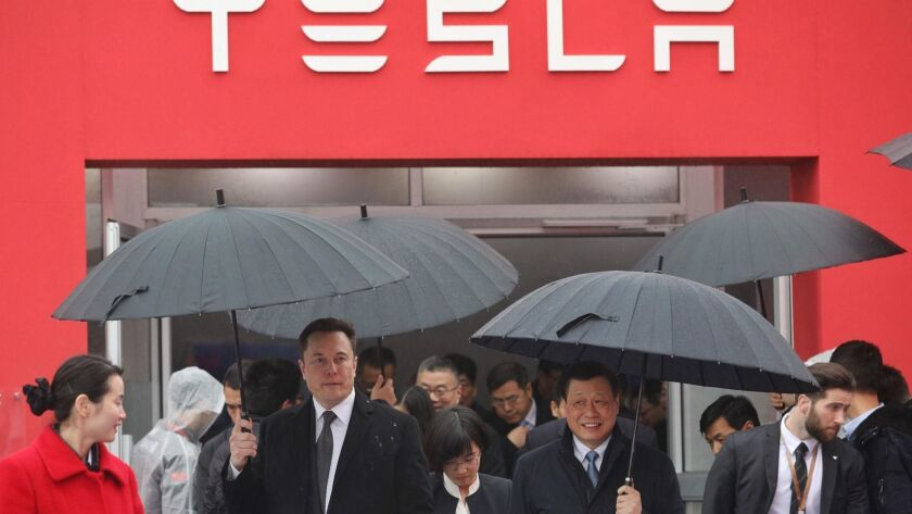 Elon Musk, left, walks with Shanghai Mayor Ying Yong during the January ground-breaking ceremony for a Tesla factory in Shanghai.