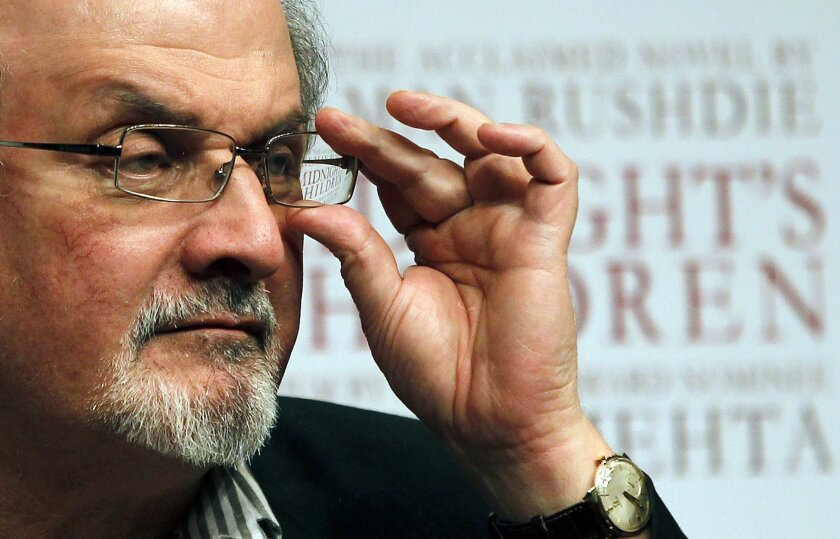 """FILE - In this Tuesday, Jan. 29, 2013 file photo, author Salman Rushdie attends a promotional event for """"Midnight's Children"""" in Mumbai, India. The Swedish Academy, which selects the winners of the Nobel Prize in literature, has condemned an Iranian death warrant against British writer Salman Rushdie, 27 years after it was pronounced. Two members quit the academy in 1989 after it refused to condemn Ayatollah Ruholla Khomeini's fatwa against Rushdie for allegedly blaspheming Islam in his book """"The Satanic Verses."""" Citing its code against political involvement, the academy issued a statement defending free expression but without explicitly supporting Rushdie. However, in a statement posted on its website Thursday, March 22, 2016 the academy for the first time denounced the fatwa and reward money for Rushdie's death as """"flagrant breaches of international law."""" (AP Photo/Rajanish Kakade, file)"""