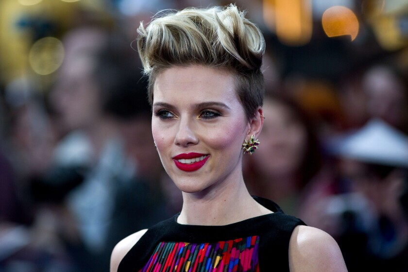 """The Avengers: Age of Ultron"" star Scarlett Johansson, seen at the film's London premiere on April 21, dishes on male costars and gets a scare from Chris Evans during her Ellen DeGeneres interview."