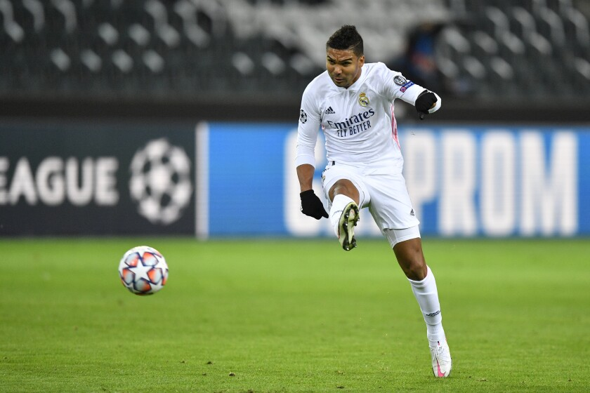 Real Madrid's Casemiro attempts a shot at goal during the Champions League group B soccer match between Borussia Moenchengladbach and Real Madrid at the Borussia Park in Moenchengladbach, Germany, Tuesday, Oct. 27, 2020. (AP Photo/Martin Meissner)