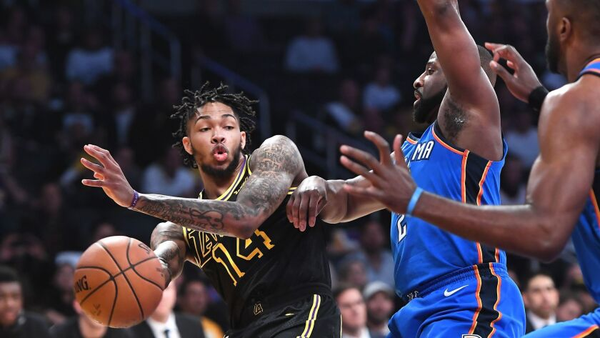 LOS ANGELES, CALIFORNIA FEBRUARY 8, 2018-Lakers Brandon Ingram gets a pass off in front of Thunders
