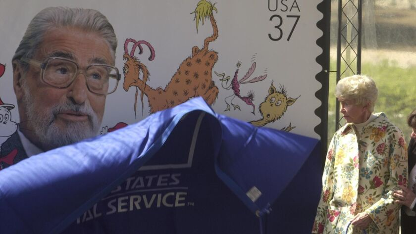 "Audrey Geisel unveils a postage stamp honoring her late husband, Ted ""Dr. Seuss"" Geisel, in 2004."