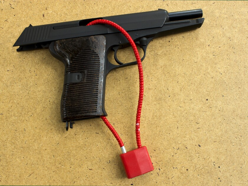 Gun locks prevent firearms from being used due to a cable running through the chamber and magazine well of a handgun.