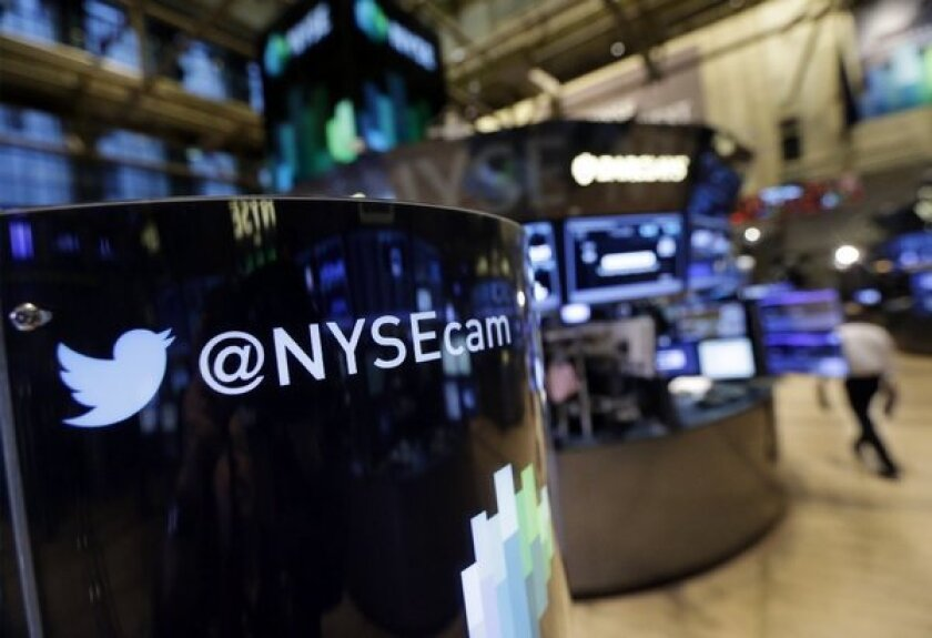 Phone post on the floor of the New York Stock Exchange features a Twitter logo. Twitter will begin trading on the New York Stock Exchange on Thursday morning after setting a price for its IPO sometime Wednesday evening.