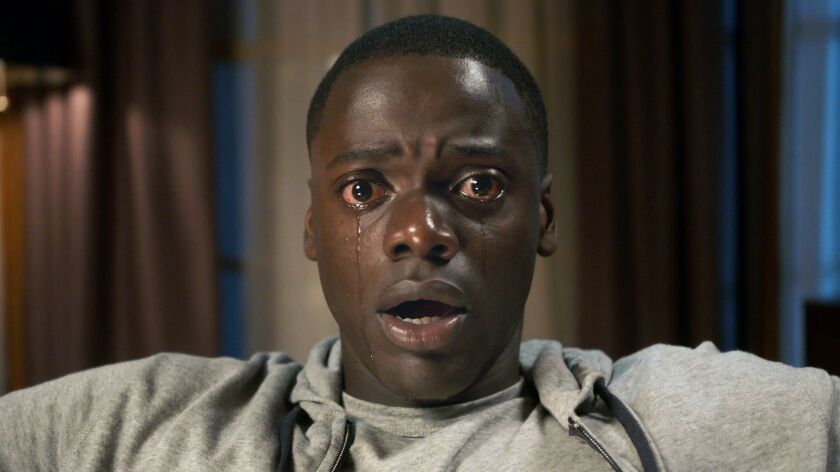 "This image released by Universal Pictures shows Daniel Kaluuya in a scene from, ""Get Out."" On Wednes"