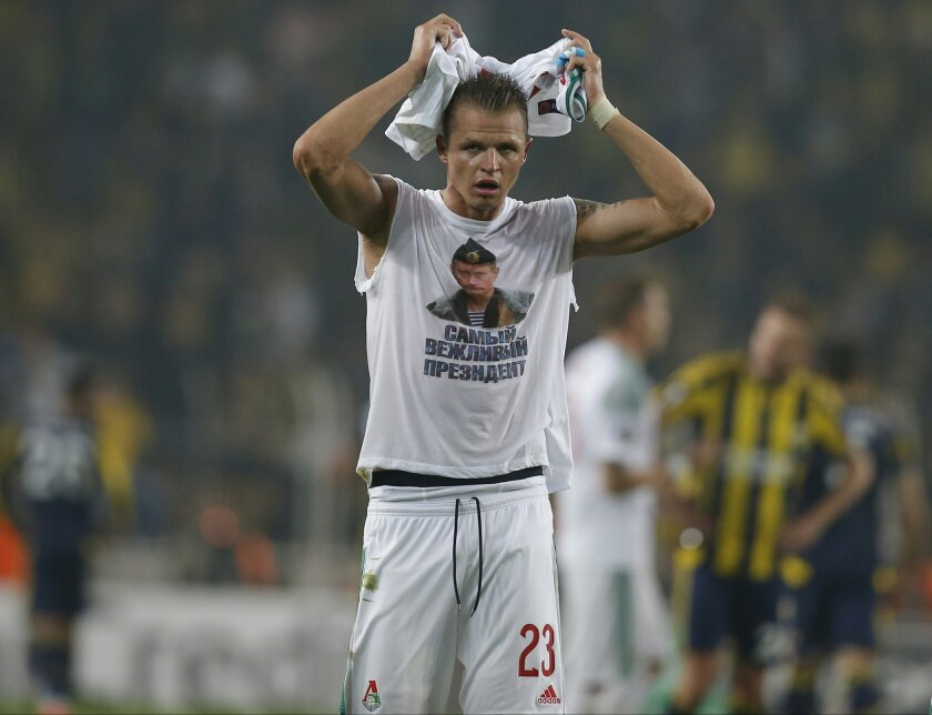 """Locomotiv Moscow's Dmitri Tarasov features an inner shirt with a picture of Russian President Vladimir Putin and the slogan """"The most polite President,"""" following a Europa League first leg round of 32, soccer match against Fenerbahce in Istanbul, Tuesday, Feb. 16, 2016.  Fenerbahce won the match 2-"""