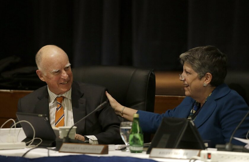 Gov. Jerry Brown, left, smiles next to University of California president Janet Napolitano at a UC Board of Regents meeting in March.