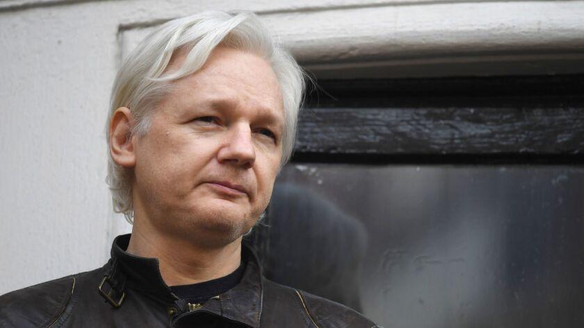 WikiLeaks founder Julian Assange speaks on the balcony of the Embassy of Ecuador in London on May 19, 2017.