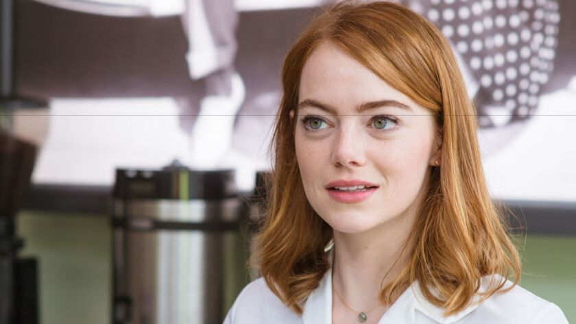 "Emma Stone as Mia in the coffee shop on the Warner Brothers back lot in ""La La Land."" The coffee shop scene was shot on the WB lot. Credit: Dale Robinette / Summit Entertainment"