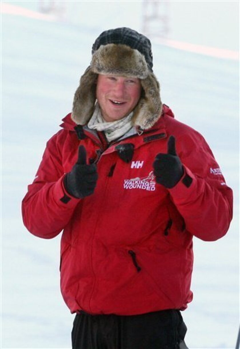 Britain's Prince Harry, gestures, during training for the Walking with the Wounded expedition, on the island of Spitsbergen, situated between the Norwegian mainland and the North Pole, Thursday March 31, 2011. The third in line to the British throne will train for three days before accompanying the