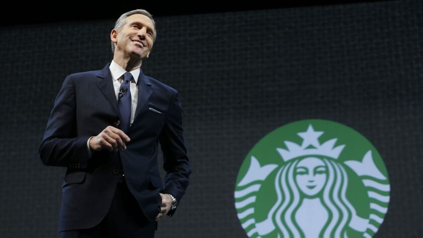 Former Starbucks CEO Howard Schultz speaks at the coffee company's annual shareholders meeting in Seattle in 2015.