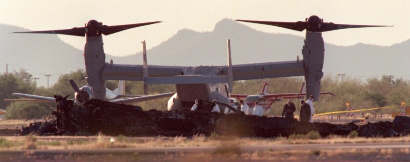 A photo from the crash site in April 2000 shows an MV-22 Osprey next to crash investigators on the ground at Avra Valley Airport in Marana, Arizona.