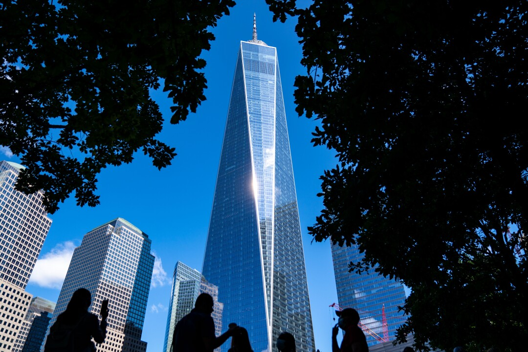 One World Trade Center is framed by trees