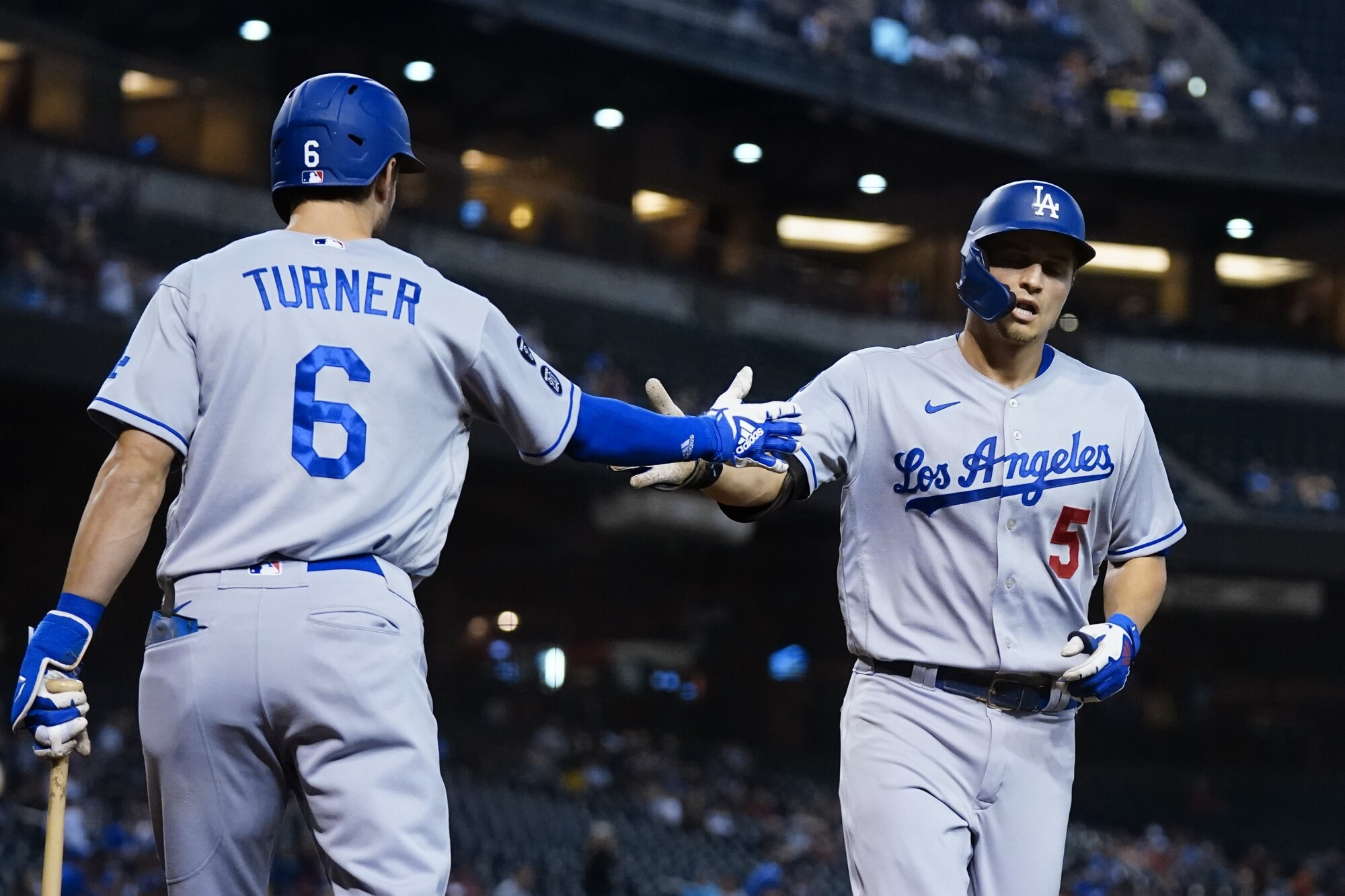 Corey Seager celebrates his first-inning home run with Trea Turner, who homered himself moments later.