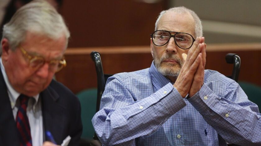 A witness testified that her now-dead friend, Susan Berman, once placed a phone call pretending to be the missing wife of Robert Durst, right.