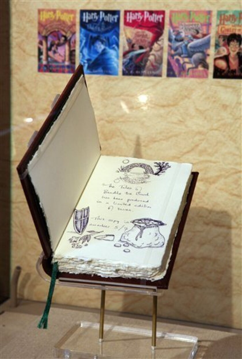 "In this image released by Scholastic, one of only seven original copies of ""The Tales of Beedle the Bard,"" created, handwritten and illustrated by J.K. Rowling, is unveiled, Wednesday, Dec. 3, 2008, at the New York Public Library. The original copy was made available for public viewing by the book�s owner Arthur A. Levine and will be on display at the library from Dec. 4 through Jan. 4. A printed edition of the book goes on sale worldwide on Thursday. (AP Photo/Diane Bondareff, Scholastic)"