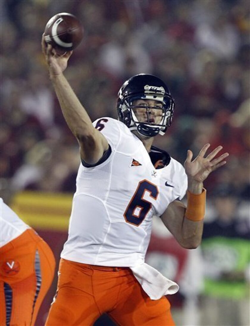 Virginia's quarterback Marc Verica throws a pass against Southern California in the first half of an NCAA college football game in Los Angeles, on Saturday, Sept. 11, 2010. (AP Photo/Alex Gallardo)