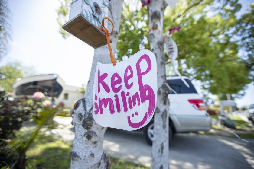 The Positive Tree on Congress Street in Costa Mesa in the Canyon Park neighborhood has encouraging messages for people walking and driving through the neighborhood on Friday, April 3.