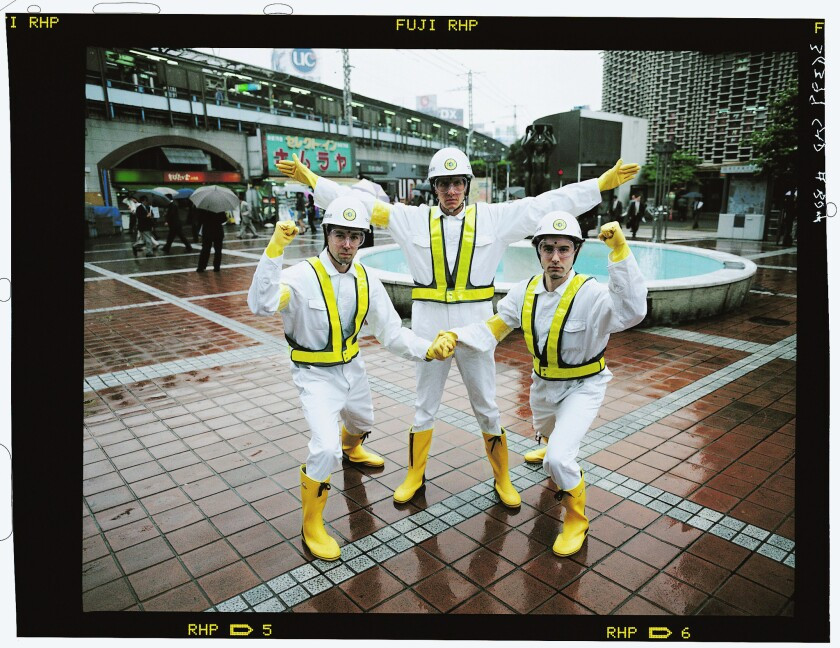 The Beastie Boys pose in Japan while filming the 'Intergalactic' video in 1998: (L-R) Adam Yauch (MCA), Michael Diamond (Mike D) and Adam Horovitz (Ad-Rock).