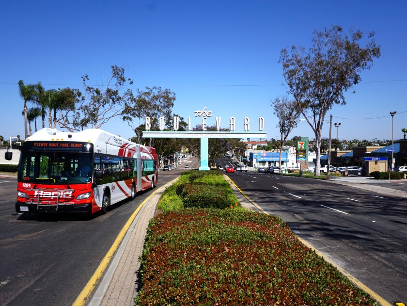A bus rides down El Cajon Boulevard, where a bus and bicycle lane was installed last spring between Park Boulevard and Fairmount Avenue.